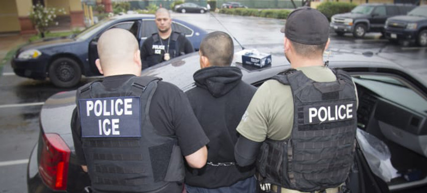 ICE arrests a man. (photo: Charles Reed/ICE)