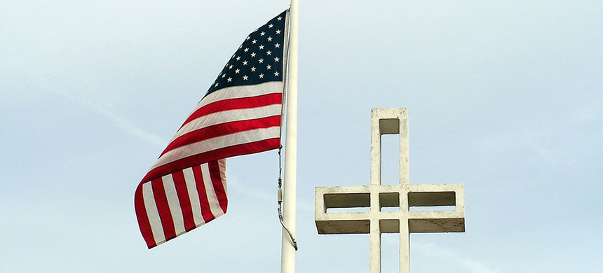 Cross and Flag. (photo: concep007/ flickr CC 2.0)