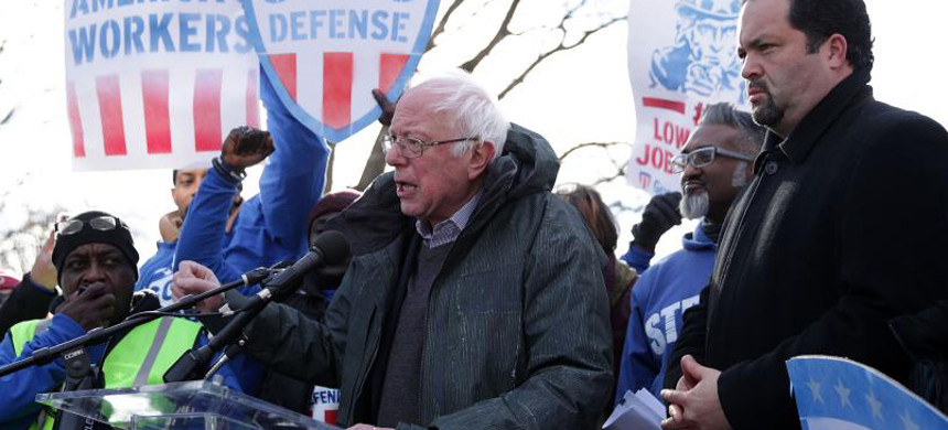 Bernie Sanders speaks as former president and CEO of NAACP Ben Jealous looks on during a rally 'to fight-back against the Republican war on the working class' on February 16, 2017. (photo: Alex Wong/Getty)