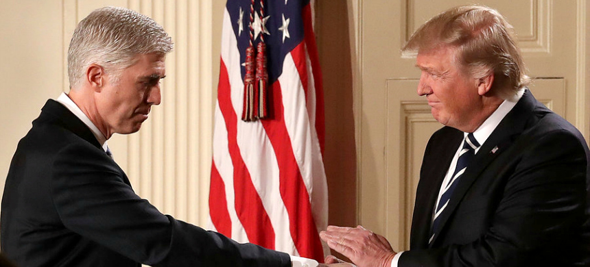 President Trump shakes hands with Judge Neil  Gorsuch after nominating him to the U.S. Supreme Court during a ceremony  in the East Room of the White House. (photo: Chip Somodevilla/Getty Images)