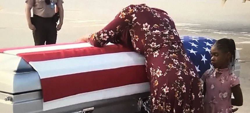 Myeshia Johnson meets the body of her husband, Sgt. La David Johnson, who died from wounds sustained during enemy contact in Niger. (photo: ABC)