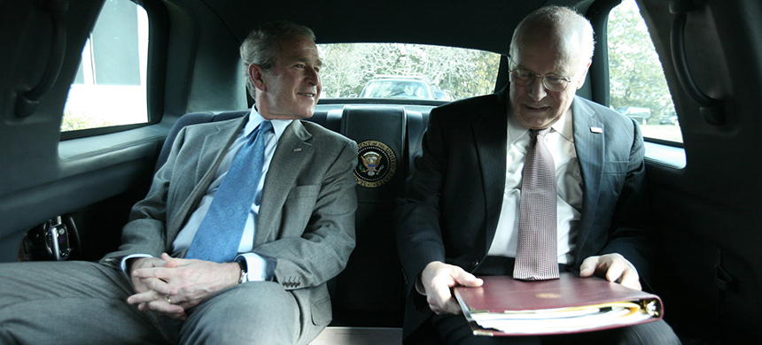 George W. Bush and Dick Cheney inside the presidential limousine in February 2008. (photo: The U.S. National Archives/Flickr)