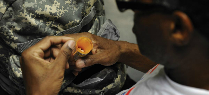 A U.S. military veteran prepares to take his medication at Central Union Mission, in Washington, D.C., which provides shelter for homeless men. (photo: Jahi Chikwendiu/Getty Images)