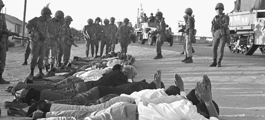 Israeli soldiers stand over captured Egyptians and Palestinians at the start of the war on June 5, 1967. (photo: Getty)