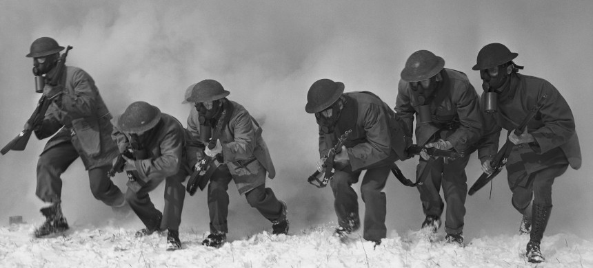 Soldiers are shown racing through a smoke screen, to which tear gas had been added by surprise to test their powers at detecting its presence, during a drill at Fort Dix, New Jersey, in 1941. (photo: Bettmann Archive/Getty)