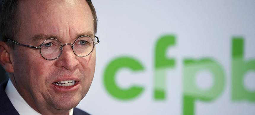 Mick Mulvaney speaks at a news conference after his first day as acting director of the Consumer Financial Protection Bureau on Monday. (photo: Jacquelyn Martin/AP)