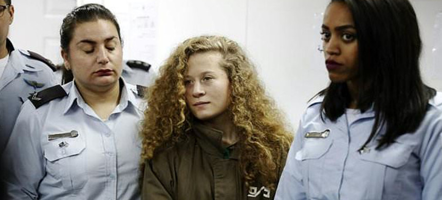 Palestinian teenager Ahed Tamimi was arrested and has been held for days by Israel for slapping an Israeli soldier. (photo: AFP)
