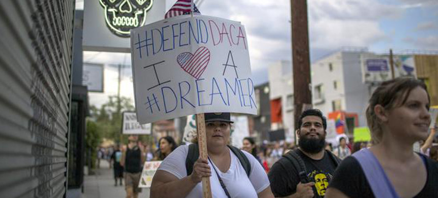 Demonstrator marches in support of DREAM Act. (photo: Getty)