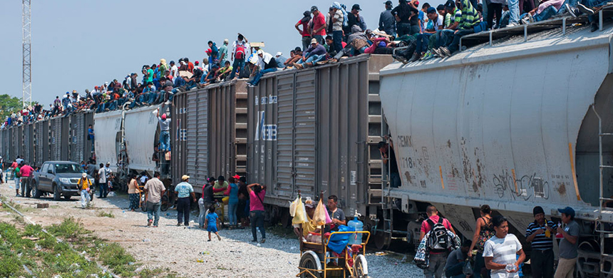 Irregular migrants atop freight train, 'La Bestia,' which takes them through Mexico towards the United States. (photo: UN Migration Agency (IOM)/Keith Dannemiller)