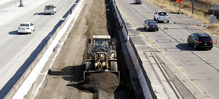 Vehicles pass a highway construction site on Interstate 80 in Sacramento, Calif in October 2015. Democrats are concerned that Trump's plan will not have enough money for projects like this. (photo: Rich Pedroncelli/AP)