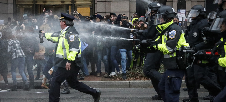 Police fire pepper spray on protesters during a demonstration after Trump's inauguration. (photo: John Minchillo/AP)
