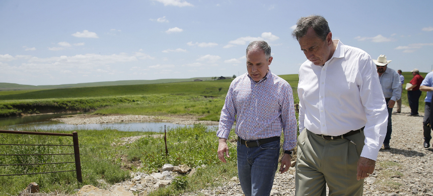 Environmental Protection Agency Administrator Scott Pruitt, left, and Albert Kelly, senior adviser, visit Bird Creek on the Chapman Ranch in Pawhuska, Oklahoma, May 26, 2017. (photo: Getty)