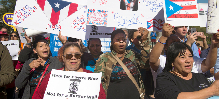 Demonstrators in Washington, D.C. hold a protest to demand more recovery assistance for areas hit by recent hurricanes, including Puerto Rico, October 18, 2017. (photo: Saul Loeb/AFP)