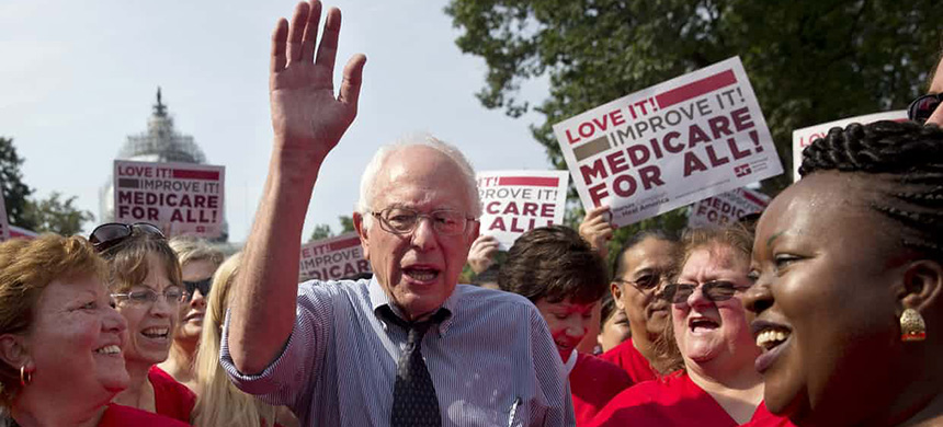 Bernie Sanders celebrates the 50th anniversary of Medicare and Medicaid two years ago. (photo: Jacquelyn Martin/AP)