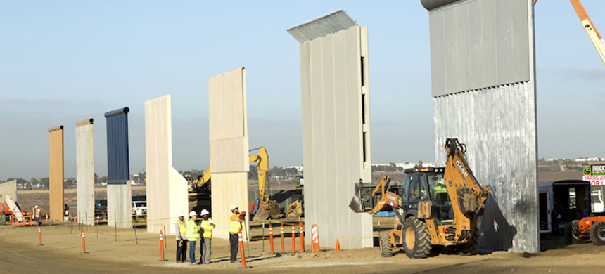Trump border wall prototypes being built in October, 2017, near the Otay Mesa Port of Entry in San Diego, California. (photo: Mani Albrecht/U.S. Customs and Border Protection/Flickr)
