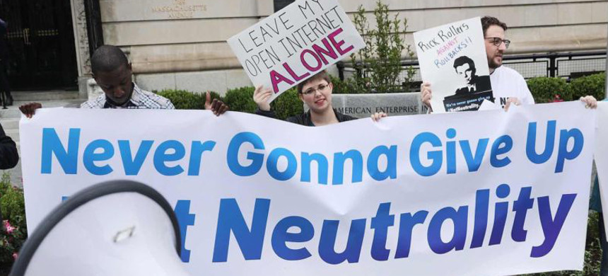 Protestors object to FCC Chairman Ajit Pai's plan to eliminate net neutrality rules before Pai's appearance at the American Enterprise Institute in Washington, DC, on May 5, 2017. (photo: Chip Somodevilla/Getty)
