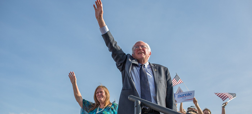 Senator Bernie Sanders and his wife Jane O'Meara Sanders wave to supporters upon taking the stage on the Burlington VT waterfront during the Bernie 2016 presidential announcement, May 26th, 2015. (photo: Arun Chaudhary)