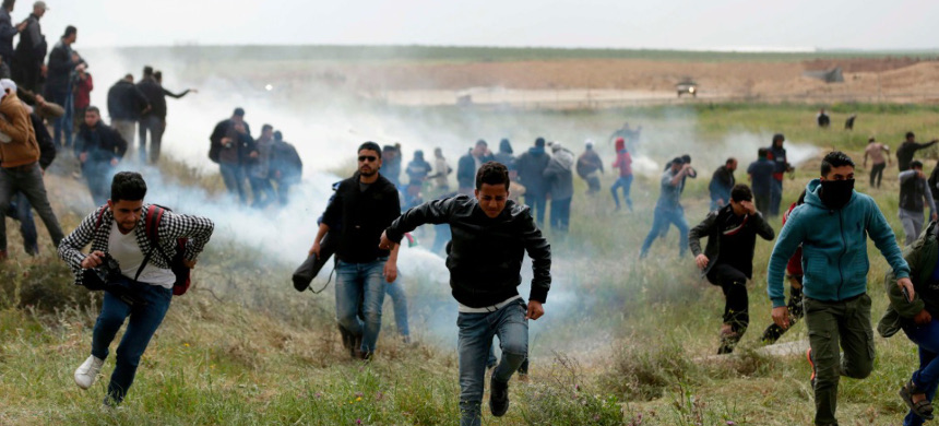 Israeli soldiers shot tear gas across the Gaza border Friday as Palestinians gathered for demonstrations that are expected to last six weeks. (photo: Mahmud Hams/Getty)