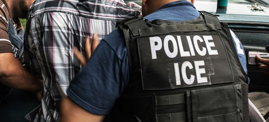 ICE agents make an arrest. (photo: Getty Images)