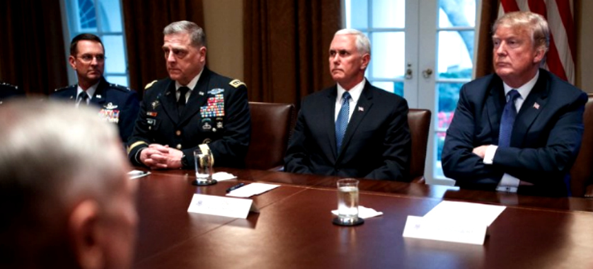 President Trump receiving a briefing on Monday from military leaders at the White House. (photo: Tom Brenner/NYT)