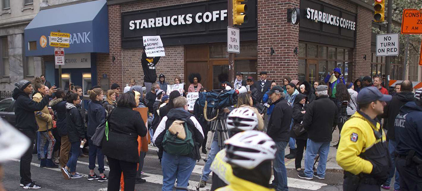 Protestors demonstrate outside the Center City Starbucks where two black men were arrested on Thursday. (photo: Mark Makela/Getty Images)