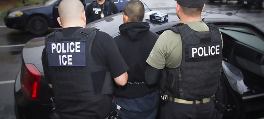 ICE agents make an arrest. (photo: Getty)