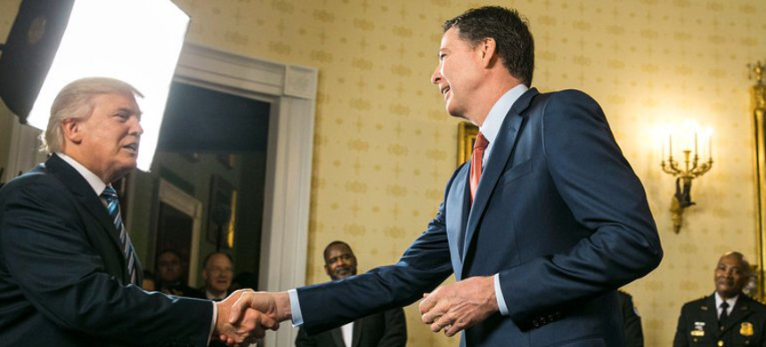 Former FBI director James Comey with Donald Trump. (photo: Getty)