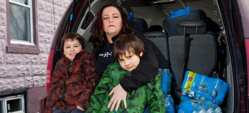 LeeAnne Walters and her twin sons, Garrett and Gavin. 'I know as far as the lead in the water that's OK, but it's the lack of trust that was never rebuilt. (photo: Garrett MacLean/Guardan UK)