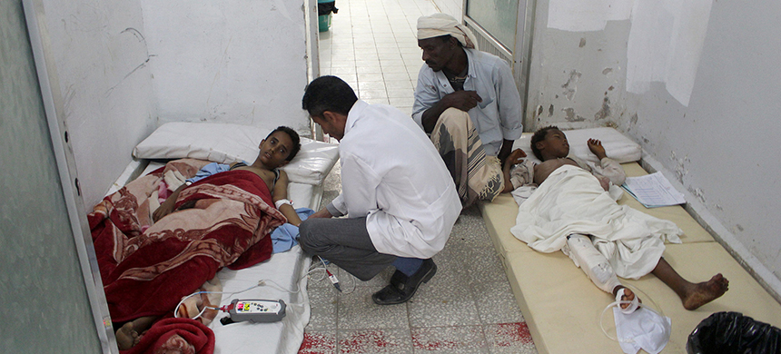 Boys injured by an airstrike on a wedding in the isolated village of Hajjah, Yemen, at a hospital on Monday. (photo: Reuters)