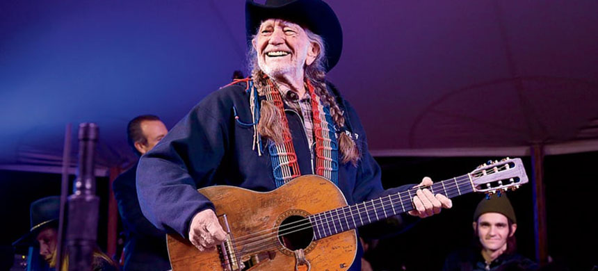 Willie Nelson performs in concert during the Luck Welcome dinner benefitting Farm Aid on March 14, 2018 in Spicewood, Texas.  (photo: Gary Miller/Getty Images)