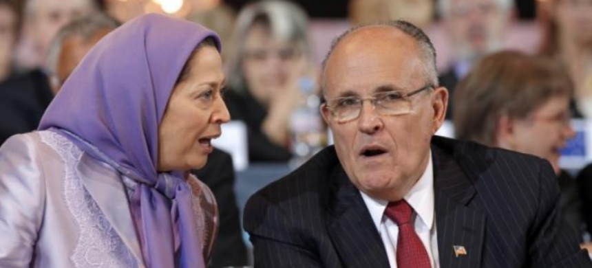 Maryam Rajavi, president-elect of the People's Mujahideen Organisation of Iran's (PMOI) political wing, the National Council of Resistance of Iran (NCRI) and former mayor of New York Rudy Giuliani take part in a rally in Villepinte, near Paris. (photo: Reuters)