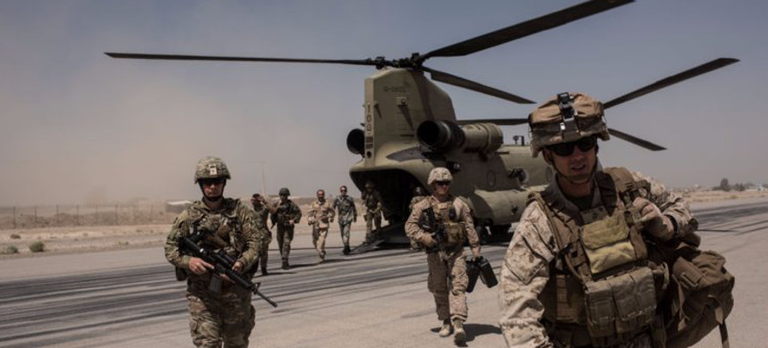 US soldiers walk off a helicopter. (photo: Andrew Renneisen/Getty)