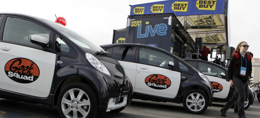 Geek Squad vehicles parked. (photo: AP)