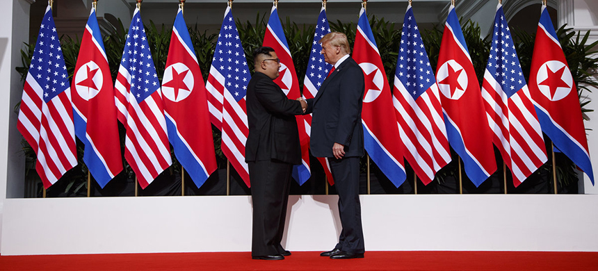 Donald Trump with Kim Jong Un. (photo: Evan Vucci/AP)