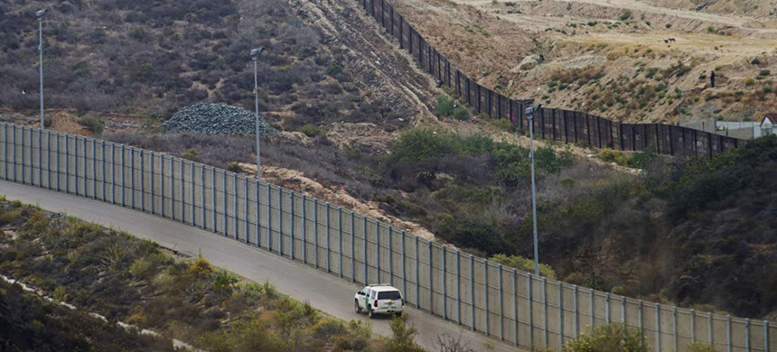 The old border wall. (photo: Getty Images)