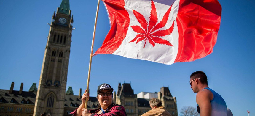 A woman celebrates National Marijuana Day in Ottawa. Canadian lawmakers voted Tuesday to legalize cannabis. (photo: Chris Roussakis/AFP/Getty Images)