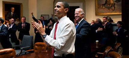 President Barack Obama, Vice President Joe Biden and White House staff react as the final health care votes are counted, 03/21/10. (photo: Pete Souza/The White House)