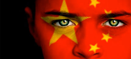 An American boy with the Chinese flag painted on his face, 06/15/09. (photo: Istock)