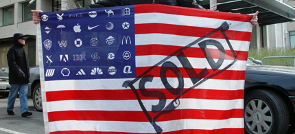 A protester holds Adbusters' Corporate American Flag. (photo: Jonathan McIntosh)