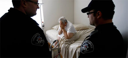 In Boulder, Colorado, the true cost of the foreclosure crisis becomes clear as a disabled former homeowner is awakened to a Sheriff's eviction, 12/11/09. (photo: John Moore/Getty Images)