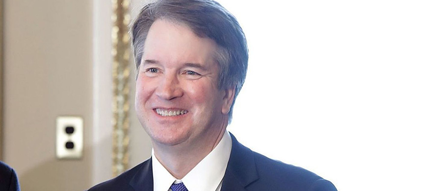 Judge Brett Kavanaugh poses for photographs before meeting with lawmakers at the Capitol on Wednesday. (photo: Chip Somodevilla/Getty Images)