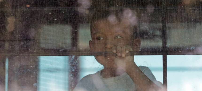 A young child behind bars in the U.S. Border Patrol Central Processing Center in McAllen, Texas. (photo: AP)