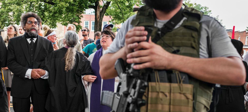 Dr. Cornel West locks arms with clergy in Charlottesville, Virginia. (photo: Jason Andrew/Getty)