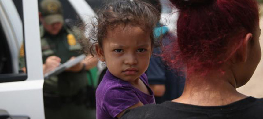 Central American family at the border. (photo: Getty Images)