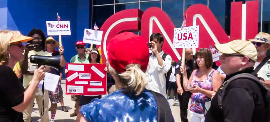 A group of protesters rally against 'fake news' outside CNN's headquarters. (photo: unknown)