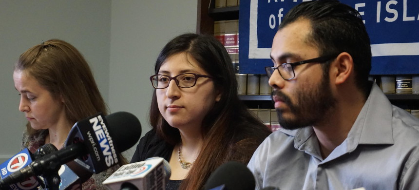 In February, Lilian Calderon (middle), alongside her husband, described her experience of being detained by ICE. (photo: Michelle R. Smith/AP)