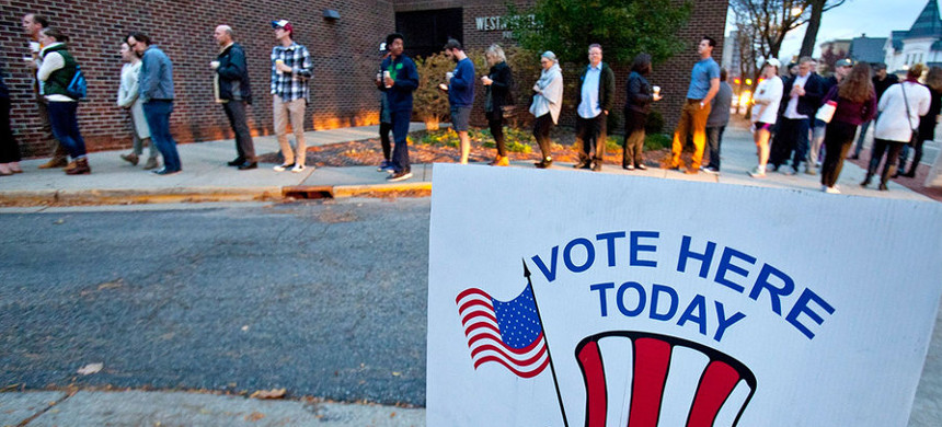 Voters line up to vote at Westminster Presbyterian Church in Grand Rapids, Michigan. (photo: Cory Morse/AP)