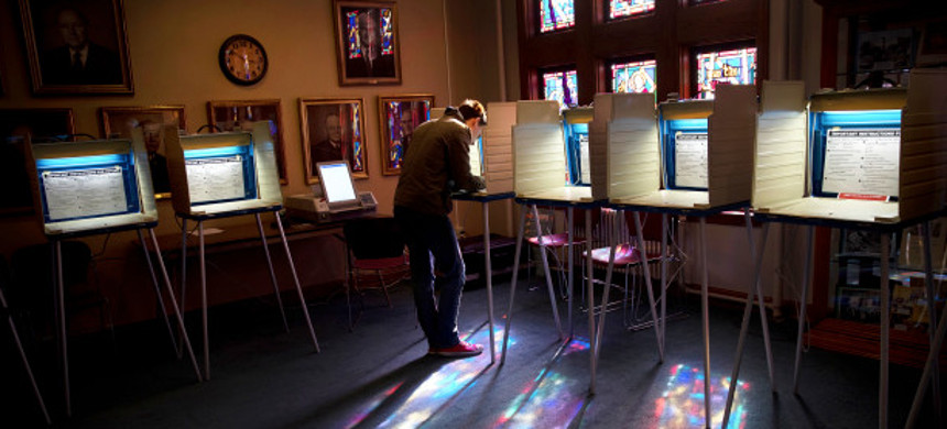 Sam Nobbs votes at the Dundee Presbyterian Church Tuesday, November 8, 2016, in Omaha, Nebraska. (photo: Megan Farmer/AP)