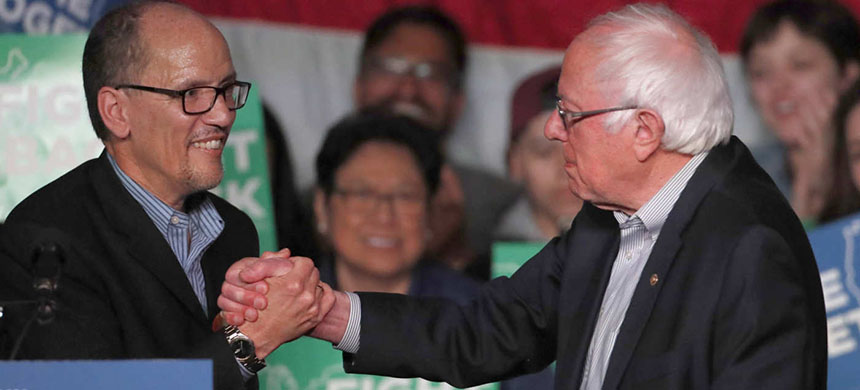 Tom Perez, chairman of the Democratic National Committee, and Senator Bernie Sanders. (photo: George Frey/Getty Images)