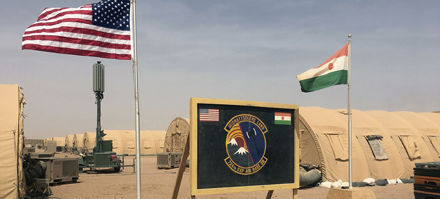 In this photo taken April 16, 2018, a U.S. and Niger flag are raised at the base camp for air forces and other personnel supporting the construction of Niger Air Base 201 in Agadez, Niger. (photo: AP)